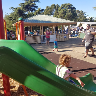 A bar and a DJ next to the playground at Halley Park in Bentleigh