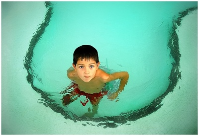Child in a swimming pool. Where did you learn to swim? Melbourne