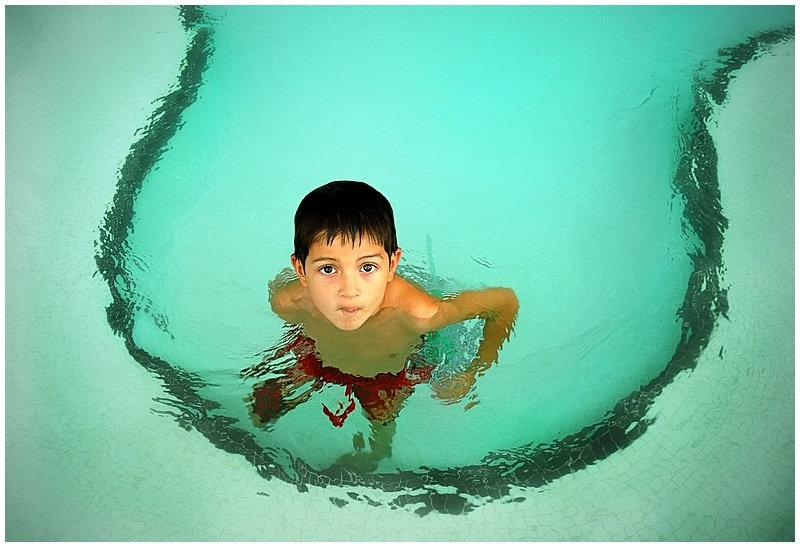Child in a swimming pool. Where did you learn to swim? Melbourne  - Where did your kids learn to swim?